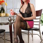 Tempting shemale Eva Lin posing in black lingerie