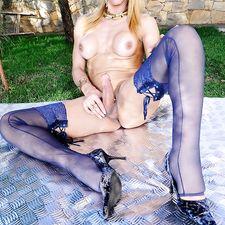 Sexy tranny Adryella poses and takes a piss