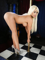 Sexy blonde shemale Kim strips and pole dances