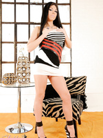 TS Ashley posing her hard cock in heels