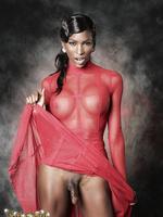 Black Natassia posing in red dress