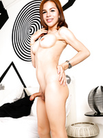 Sweet asian ladyboy strokes her cock