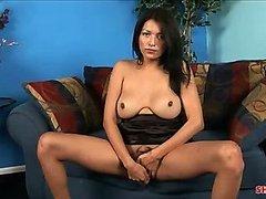 Cute busty brunette shemale inserts purple dildo in her ass