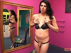 Hot brunette shemale shows off her amazing body