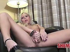 Mature shemale gets comfortable on her boyfriends leather chair