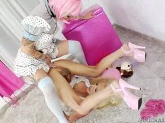 Beautiful blonde shemale takes purple strap on from girlfriend