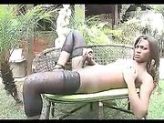 Beautiful black tranny jerks off outdoors in black stockings