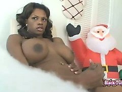 Black tranny with huge bust jerks off with Santa