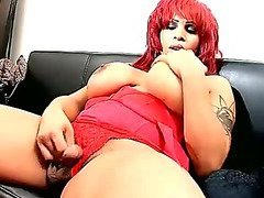 Busty black tranny with red hair shoots hot solo scene