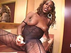 African shemale masturbates in hotel room for you