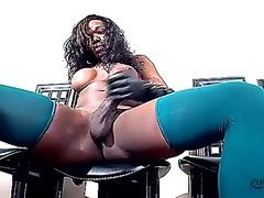 Black shemale with curly hair plays with her big hose