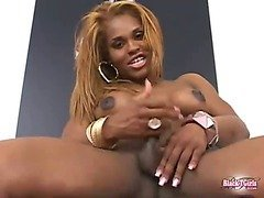 Black passable tranny poses with her amazing body