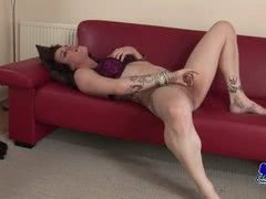 Mature shemale likes to get off on her red couch