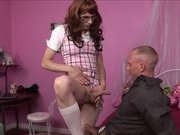 Redhead shemale rides a stud in a pink room