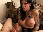 Brunette shemale bows down and sucks a big cock
