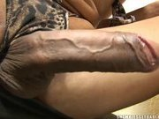 Black Brazilian tranny shows off her big cock and fucks