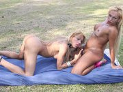 Two mature trannys fuck in the park during the afternoon