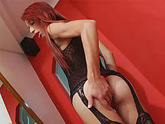 Tight redhead shemale Bruna Kobolt strokes her cock