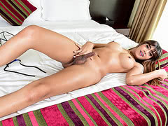 Shemale May A teases in a masturbation demonstration