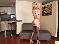 Blonde little cutie with big hard shecock toying her ass