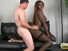 Chocolate skinned busty shemale takes white dick in her ass