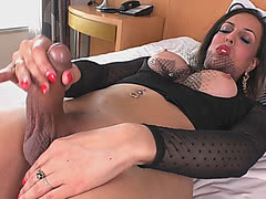 Busty tranny jerks off and fucks her big ass with a dildo