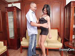 Long haired exotic tranny beauty bouces on a monster cock