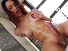 TS Anna Hickhiman playing with her big hard oiled dick