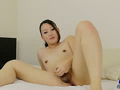 Cute little Asian ladyboy rubbing her small cock
