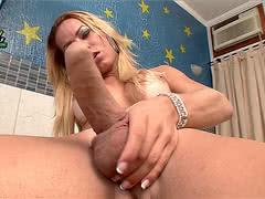 Rakel Rodrigues shows her fantastic body and rubs her big cock