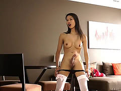 Stunning asian ladyboy posing in white stockings
