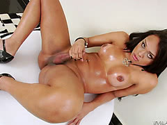 Sexy wet Latina shemale plays with her gaping ass