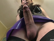 Burnette shemale shows off her purple skirt and nice cock