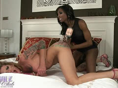 Natassia Dreams fucks Morgan Bailey with a bottle