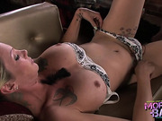 Shemale Morgan Bailey fingers her ass while jerks