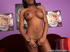 Black Asian tranny cums over her stomach