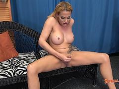 Busty blonde shemale Venus De Cuellar masturbates