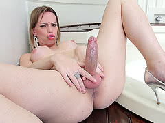 Hot shemale Alessandra Leite takes huge cock in her tight tranny ass