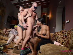 Natassia Dreams and TS Foxxy sucking 2 dicks
