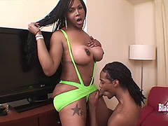 Chubby black tranny grinds down on huge cock
