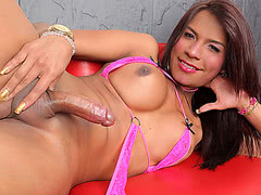 Sexy and beautiful Mia Conty loves toying her shemale ass