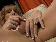 Tattooed redhead shemale masturbates on the couch