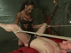 Black shemale dom fucks a tied white slave