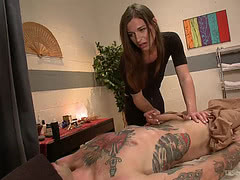 TS Michele fucks tattooed dude on the massage table
