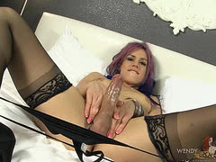Rock hard Kelli stroking in stockings