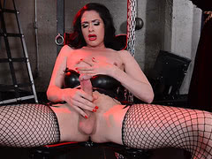 Huge cock Penny stroking in dungeon