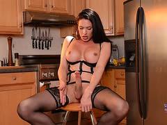 Penny jerks her big dick in stockings