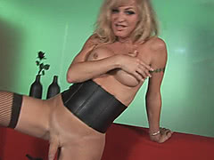 Mature shemale blonde in black leather