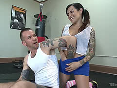 Horny tgirl Foxxy seduces a rookie in the gym