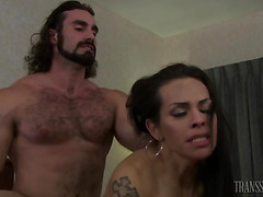 Stunning TS Foxxy raw ass fucked by a big hairy guy